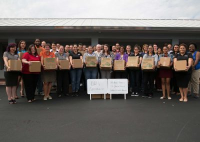 Interstate Title Solutions group picture of donating 2018 Thanksgiving meal boxes